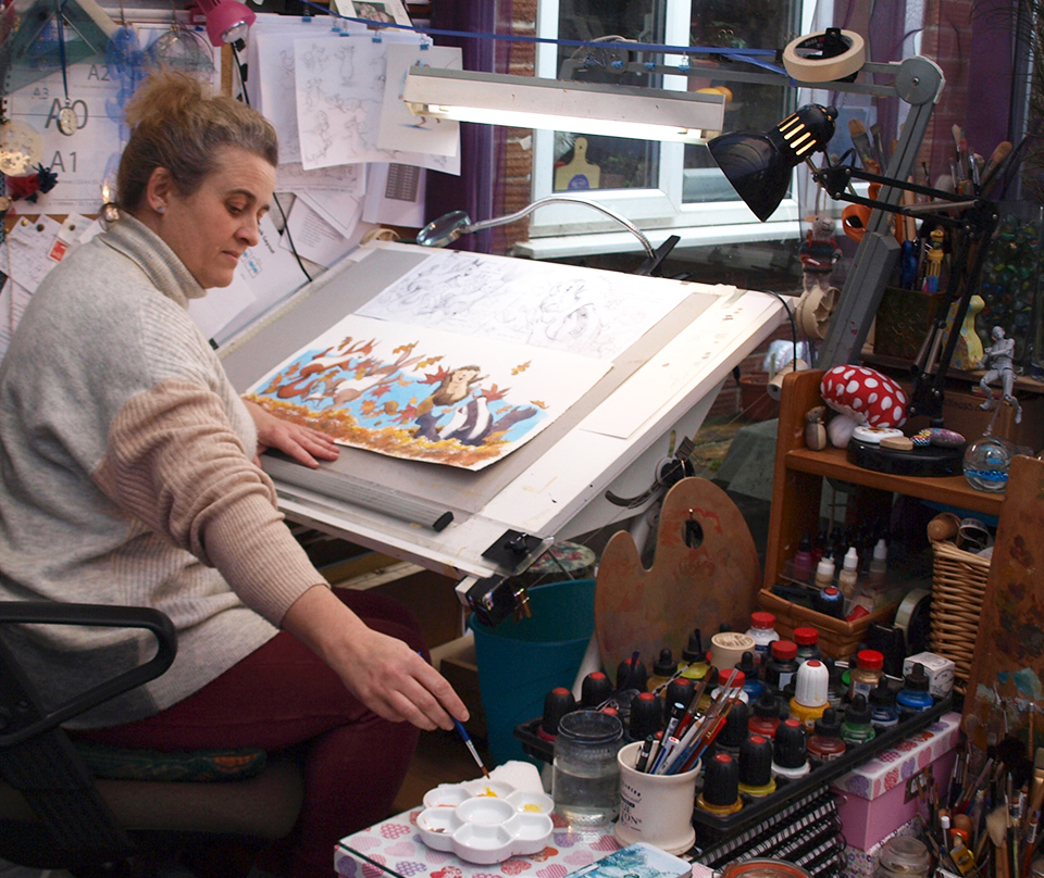 Emma Graham in her studio working on illustration of woodland creatures